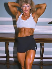 Theresa Nabors in shorts/halter outfits has very deep cut abs