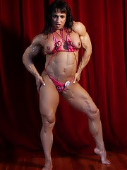 Tazzie Colomb definitely knows her way around a professional bodybuilding stage. But you won't see this amazon posing like this in a public competition. She feel free to go topless and nearly nude to show You her spectacular, vascular biceps, pecs and abs, and her strong glutes and massive legs.