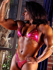 Muscle clad Tonia Moore flexes in a sexy pink bikini