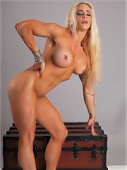 IFBB Pro Physique competitor Jill Jaxsen flexing her muscles and rubbing all over her body.