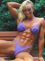 Karen Netterstrom has a beautifully balanced physique, though her upper-body stands out somewhat with outstanding biceps, chest and back. Theresa's legs are very developed and feature deep-cut calves. Karen's trademark pose is her unreal abdominal muscles, one of the deepest 6-packs we have ever seen.