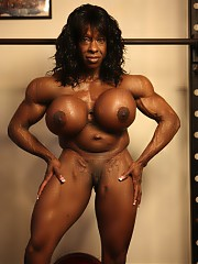 Female bodybuilder Yvette Bova is in the gym. Look at those huge pecs, ripped abs and vascular ebony biceps as she poses naked for you, then enjoy looking at her massive legs, great glutes and her bare feet.