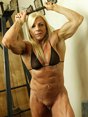 Lacey looks amazing showing of her huge biceps, ripped quads, and her juicy big clit.