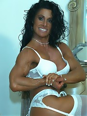 Debbie Bramwell in white lingerie outfit with the best biceps